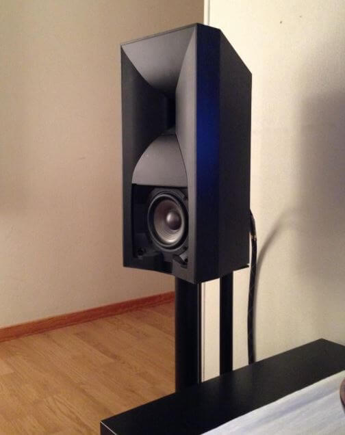 image of the jbl 530 on a bookshelf speaker stand